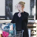 Charlize Theron stops by Whole Foods in West Hollywood, California to stock up on groceries on January 5, 2015