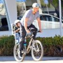 Josh Duhamel is spotted enjoying a bicycle ride with his growing son Axl on January 8, 2016 in Brentwood - 454 x 394
