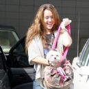 Miley Cyrus And Justin Gaston With White Puppy In Hollywood - 03/14/09