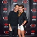 Maria Menounos (R) and Keven Undergaro attend a private party celebrating CES 2014 hosted by iHeartRadio featuring a live performance by Krewella at Haze Nightclub at the Aria Resort & Casino at CityCenter on January 8, 2014 in Las Vegas, Nevada.