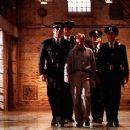 Prison guards Tom Hanks, David Morse, Barry Pepper and Jeffrey DeMunn escort prisoner Michael Jeter in Castle Rock's The Green Mile - 12/99
