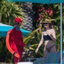 Behati Prinsloo in Animal Bikini on the pool in Cabo
