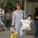 Helena Christensen in Pin-striped jumpsuit in West Village