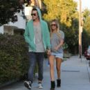 Ashley Tisdale showing off her ring with fiance Christopher French (August 13)