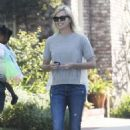Charlize Theron in Ripped Jeans out in Hollywood