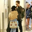 Vanessa Hudgens and Austin Butler at LAX Airport in LA - 454 x 588
