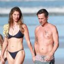 Gisele Bundchen in Black Bikini – Takes a Morning Walk on the Beach in Costa Rica - 454 x 896