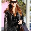Kate Walsh makes a few hearts skip a beat in décolletage-baring top