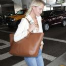 Poppy Delevingne – Arriving at LAX Airport in Los Angeles - 454 x 713