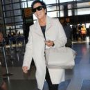 Kris Jenner departing on a flight at LAX airport in Los Angeles, California on September 22, 2014