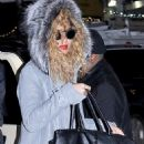 Beyoncé Knowles - Beyonce walking with a bodyguard in New York City, January 28, 2011
