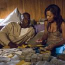 Tyrese Gibson as O2 and Meagan Good star as Coco in Action / Crime Rogue Picture movie Waist Deep - 2006