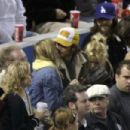 KATE HUDSON WITH HUSBAND CHRIS ROBINSON AND HER BROTHER OLIVER HUDSON WITH HIS GIRLFRIEND VINESSA SHAW AT THE DODGERS/ATLANTA BRAVES GAME, DODGER STADIUM, LOS ANGELES, CA. - 454 x 303