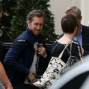 "Christian Bale, Anne Hathaway and Joseph Gordon-Levitt spotted leaving Paris after ""The Dark Knight Rises"" premiere cancelled (July 21)"