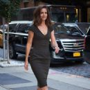 Katie Holmes – In dark green dress while entering her hotel in NYC