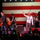 Musician Kid Rock performs during a campaign rally for Republican presidential candidate and former Massachusetts Gov. Mitt Romney at the Royal Oak Theatre on February 27, 2012 in Royal Oak, Michigan. Michigan residents will go to the polls on February 28 - 454 x 303