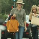 Ashley Tisdale was spotted shopping with Hilary and Haylie Duff this past Sunday, September 25, in Los Angeles - 392 x 600