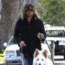 Billy Ray Cyrus takes his dogs out for a relaxing stroll through his neighborhood in Toluca Lake, California on April 4, 2014 - 451 x 594