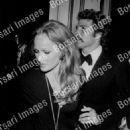 Ursula Andress and Ryan O'Neal - 454 x 572