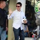 "Tom Cruise stops at Starbucks to grab a Frappuccino in Pittsburgh, where he is shooting his new film ""One Shot!"""