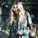Khloe Kardashian is spotted leaving a studio in Los Angeles, California on March 28, 2017 - 454 x 575