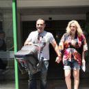 Katerina Karavatou and Krateros Katsoulis- leaving the maternity clinic - 454 x 569