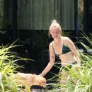 Sophie Turner in Green Bikini at the pool in Miami