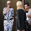 Amber Rose and Tara Reid were spotted posing for fans as they stepped out of their hotel in New York, New York - April 6, 2012 - 366 x 594