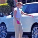 Dakota Fanning – Moving boxes from her car into a home with a friend in Los Angeles