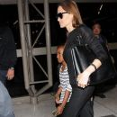 Brad Pitt and Angelina Jolie at the LAX Airport  (June 6, 2014)