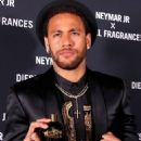 Neymar smoulders in a sleek black blazer, matching shorts and a gold-embellished shirt as he launches new Diesel fragrance