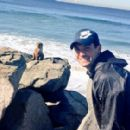 Grigor Dimitrov takes picture with a seal on the beach