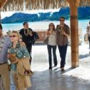 L to R: Jason Bateman, Kristen Bell, Jon Favreau, Kristen Bell, Jason Bateman, Kristin Davis and Faizon Love in the scene of Universal Pictures' Couples Retreat.