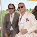 Photographer Sante D'Orazio and Carlos Souza pose at the VIP Marquee during the fifth Annual Veuve Clicquot Polo Classic on June 2, 2012 in Jersey City