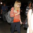 Lauren Conrad wears a striped shirt and glasses as she arrives at LAX Airport in Los Angeles on August 6, 2013