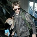 Vanessa Hudgens and Austin Butler at LAX Airport in LA - 454 x 526
