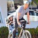 Josh Duhamel is spotted enjoying a bicycle ride with his growing son Axl on January 8, 2016 in Brentwood - 454 x 600