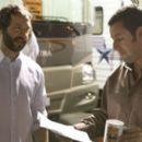 Director/Writer Judd Apatow with Adam Sandler on the set of Funny People.