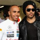 Lewis Hamilton of Great Britain and McLaren talks with musician Lenny Kravitz in his team garage during practice for the Australian Formula One Grand Prix at the Albert Park circuit on March 16, 2012 in Melbourne, Australia