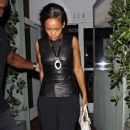 Rihanna shields her eyes from camera flashes as she leaves Il Ristorante di Giorgio Baldi