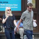 A smitten looking Dakota Fanning and her boyfriend Jamie Strachan go hand in hand for a stroll around New York City - 394 x 594