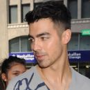 Joe Jonas was spotted greeting fans outside his hotel today, August 22, in New York City