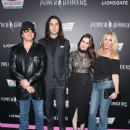 Nick Simmons, Shannon Tweed, Gene Simmons and Sophie Simmons at The LA Premiere of Saban's Power Rangers presented by Lionsgate at Fox Bruin Theatre on March 22, 2017 in Los Angeles, California - 439 x 600