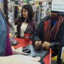 """Selena filming """"The Revised Fundamentals of Caregiving"""" at a store in Atlanta, Georgia"""