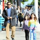 Adam Sandler takes his daughters Sadie and Sunny out for lunch in Brentwood, California on December 29, 2014