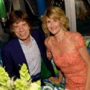 Mick Jagger and actress Laura Dern attend HBO's Annual Primetime Emmy Awards Post Award Reception at The Plaza at the Pacific Design Center on September 22, 2013 in Los Angeles, California - 454 x 321