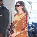 Anne Hathaway at JFK Airport in New York - 454 x 570