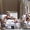 "Brooke Hogan and her dad Hulk Hogan ""relaxing at poolside"