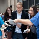 Charlie Hunnam gets mobbed by fans as he leaves the Hard Rock hotel to head to Comic Con. July 14, 2012 San Diego, California - 416 x 594