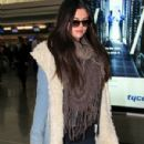 Selena Gomez makes her way through the airport at JFK in New York City. January 18, 2012 - 300 x 594